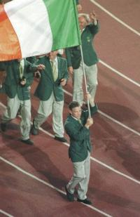 Francis Barrett—here carrying the flag for Ireland at the opening ceremony of the 1996 Atlanta Olympics—has become a role model for other members of the Travelling community. (Billy Strickland/INPHO)