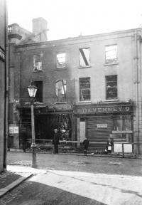 A burnt-out Catholic-owned shop in Bow Street, Lisburn, in August 1920. (Mooney Collection)