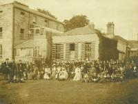 Parents and pupils at a St Enda's open day at the Hermitage, Rathfarnham. Pearse is amongst the group of smaller boys sitting on the grass to the right. (Pearse Museum)