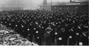 Ranks of factory workers (probably at the Sirrocco Works, Belfast) with UVF armbands. (PRONI)