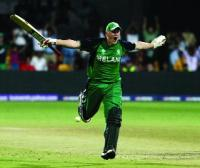 Kevin O'Brien, having just scored the fastest-ever century in World Cup cricket, celebrates Ireland's stunning three-wicket win over England in Bangalore on 2 March 2011.