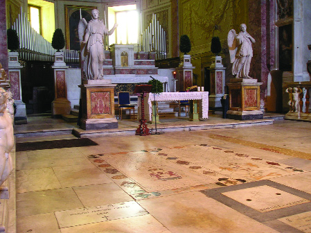 "Pl. 3: View over the grave-slabs of Hugh, baron of Dungannon, and Rory O'Donnell, earl of Tyrconnell, showing the Azzurri family vault hatch (bottom right) and commemorative slab to Hugh O'Neill laid by Cardinal Tomás í"" Fiaich in 1989 (bottom left)."