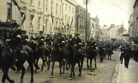The Enniskillen Horse—what can now be identified as the first formed UVF regiment—parading through the town on 18 September 1912 to welcome Sir Edward Carson's visit to launch the Ulster Covenant campaign. (PRONI)