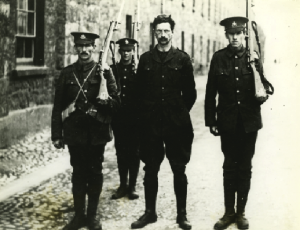 Above: The large photograph at Kilmainham Gaol of de Valera under arrest in 1916, with the caption: 'Sentenced to die like the other leaders, de Valera would have been the fifteenth man executed at Kilmainham had he not been saved by his American citizenship'. (UCD Archives)