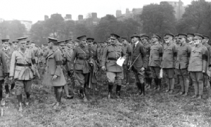 British commander General John Maxwell (holding paper, while reviewing troops in Trinity College, Dublin, 1916) inquired whether de Valera might cause future trouble. 'I wouldn't think so, sir, I don't think he is important enough', W.E. Wylie, chief prosecuting officer, is quoted as replying. (RTÉ Stills Library)