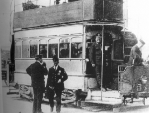 Above: A DMP constable guarding a tram during the Lockout. (Garda Museum)