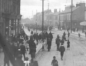Picketers throw stones at Cameron Highlanders as they advance up the Grosvenor Road, Belfast, August 1907. (Alex R. Hogg)