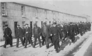 Scab labour being escorted to work in Pierce's foundry by RIC constables in King Street, Wexford. (Alice White)