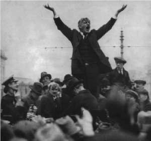 The famous photograph of James Larkin that inspired the monument, taken by Joe Cashman in April 1923. Biographer Emmet O'Connor has observed that the less-than-animated response of the O'Connell Street crowd 'speaks volumes about the difference between 1913 and 1923, and Larkin's inability to see this'. (RTÉ Stills Library)