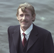 Peter O'Toole as Jim Larkin (given slightly more prominence here than in the novel) addressing the men from a boat on the River Liffey.