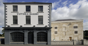The museum is located in premises vacated by McCann's Bakery in 1996 (original façade on the left), underneath which was revealed Nicholas Bagenal's castle (right).