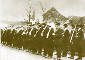 Early days—still without uniforms or weapons, Irish Volunteers drill with hurleys (date and location unknown). But how revolutionary were they?