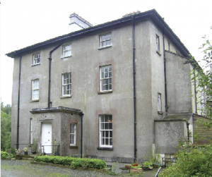 Corravahan House—a plain, square, three-storey-over-basement glebe house built in 1837–41. (NIAH)