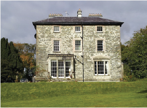 The south front features two tripartite windows with one mullioned in the style of James Wyatt (1746–1813). (NIAH)