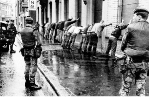 A random British Army search operation in Belfast c. 1971. Kitson proposed a 'chain reaction system' of intelligence-gathering whereby the accumulation of masses of low-grade 'background intelligence' would generate 'contact information', which would then expose the enemy for elimination. (An Phoblacht)