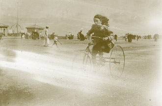 A young female 'scorcher' at the seaside. (NLI)