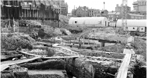 Above: A view of Wood Quay in the late '70s, showing the city wall and early Hiberno-Norse river defences under excavation. The remains were astonishing: complete foundations of wattle-and-daub houses; interior hearths and benches; workshops; timber pathways and boundary fences; and even latrines and rubbish pits filled with unique artefacts. (N.C.B. Maxwell)