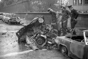 The wreckage of the third Dublin bomb (c. 5.32pm) at South Leinster Street (with Trinity College railings in the background), where two women were killed instantly. Seven more people would be killed when a fourth bomb exploded outside Greacan's pub in Monaghan town at c. 6.58pm. (Dublin City Public Libraries)