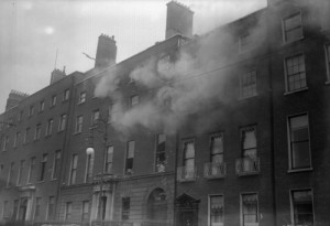 Fowler Hall (with the lamppost outside), 10 Rutland (now Parnell) Square, headquarters of Dublin's anti-Treaty IRA, smouldering during the Civil War in June 1922. Prior to being taken over by the IRA it had been an Orange hall and home to the majority of Dublin's 2,000 Orange brethren. Thirteen years later (above) the Irish Times would report on its cellar's secret. (Walshe/Topical Press Agency/Getty Images)