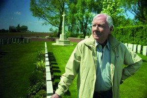 Gay Byrne at Lone Tree Cemetery in West-Flanders—mostly containing the graves of soldiers of the Royal Irish Rifles killed on the first day of the Battle of Messines in June 1917