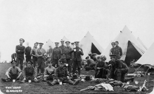 Men of the 2nd Battalion, Royal Munster Fusiliers, take a break while sorting kit at Blandford Camp, England, September 1910. (Imperial War Museum)