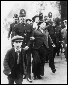 Arrested when protesting at Buckingham Palace, Metge (between two officers in the rear of the picture) was shocked at the way the police treated the suffragettes.