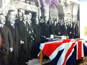 In Northern Ireland the 'decade of centenaries' got off to a lively start, for unionists, with debates and parades in 2012 to mark the centenary of the signing of the Ulster Covenant—such as this exhibition by the Grand Lodge of Ireland at Schomberg House, Cregagh Road, Belfast. But three years on, the Stormont Executive still has no agreed programme for the Decade of Commemorations. (Unionist Centenary Committee)