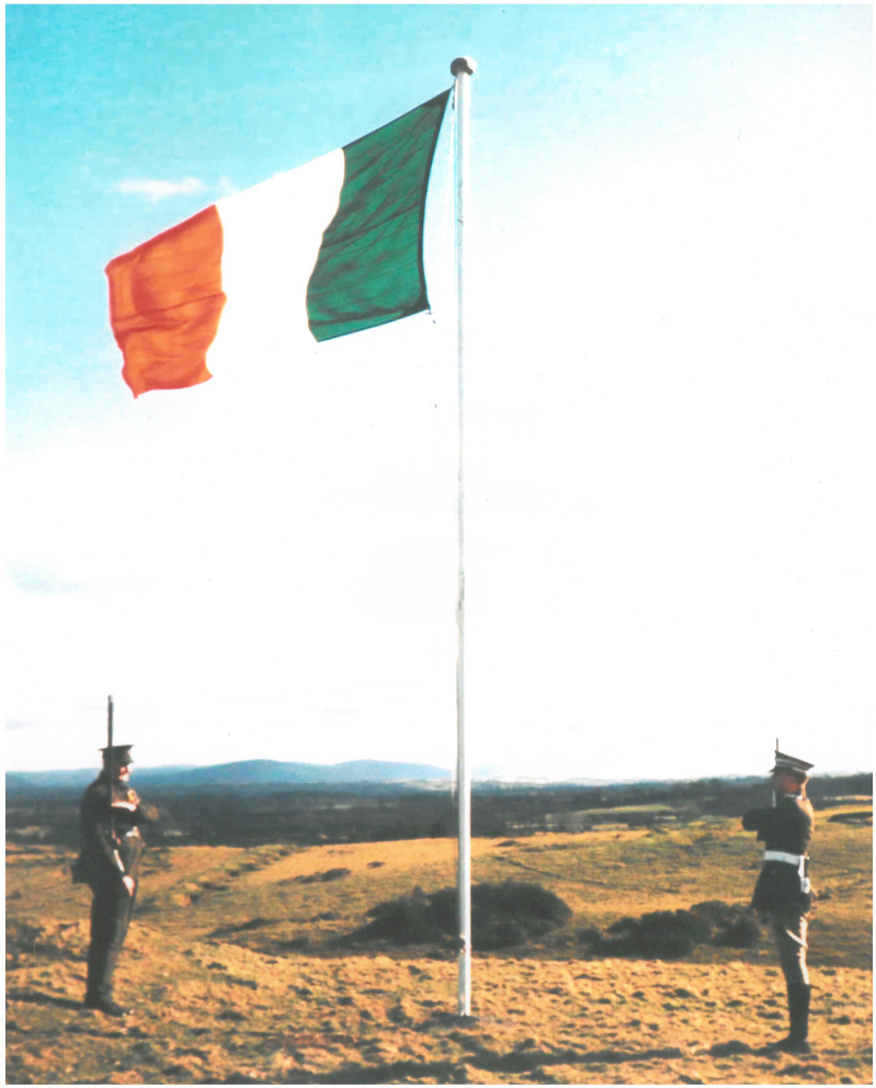 Saluting the flag. The photograph shows Volunteer Sean O'Duffy and Cadet Frank Russell saluting the National Flag at the Curragh in Easter 1966. Volunteer O'Duffy was wearing the uniform he wore on active service in Easter Week, 1916. (Photo: National Library of Ireland)
