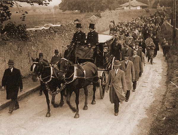 Above: The funeral cortège of Mrs Margaret Pearse, mother of the Pearse brothers, passing along the exterior wall of St Enda's, Rathfarnham, in April 1932. (South Dublin Libraries)