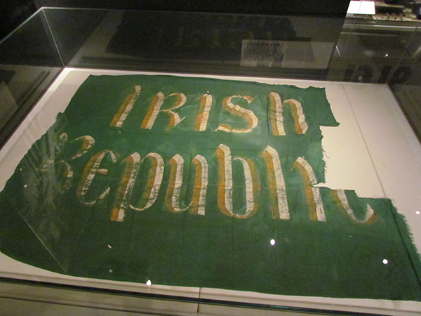 Above: The 'Irish Republic' flag that flew over the GPO at the corner of Prince's Street at Easter 1916, now on display in the National Museum, Collins Barracks. (NMI)