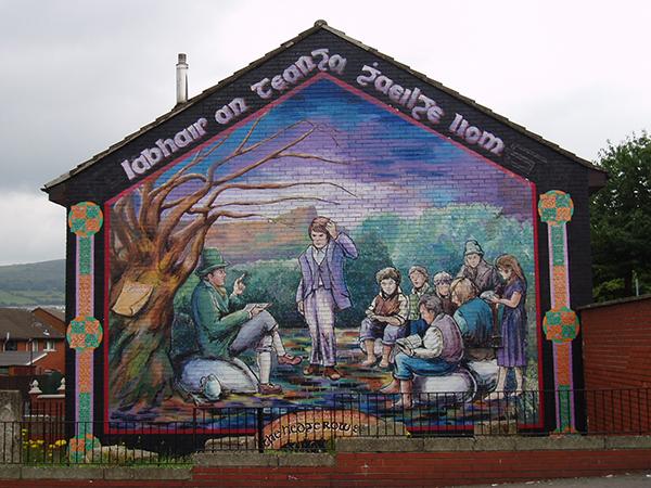 Above: A mural in Belfast depicting a hedge school. (extramuralactivity)